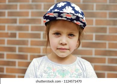 portrait of the cute little girl wearing cap