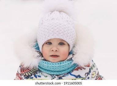 Portrait of a cute little girl in winter