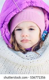 Portrait of cute little girl in winter park