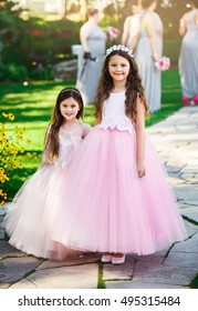 Portrait of cute little girls on awesome white dresses on first holy communion