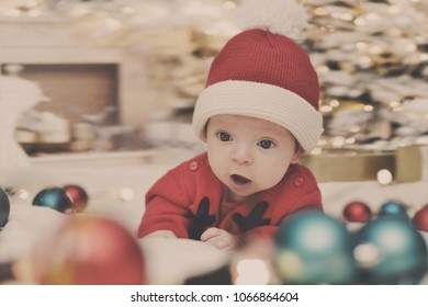 portrait of cute little newborn baby  in christmas clothes and wearing santa hat