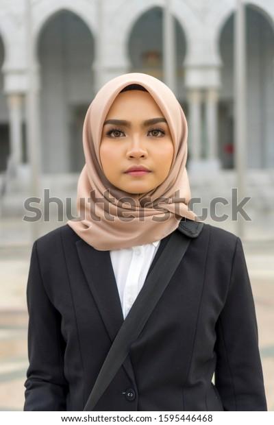 Portrait of Cute Malay Woman wearing hijab outdoor