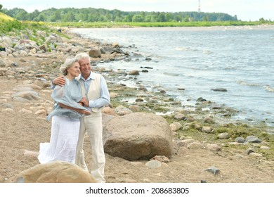 Portrait of cute mature couple at beach