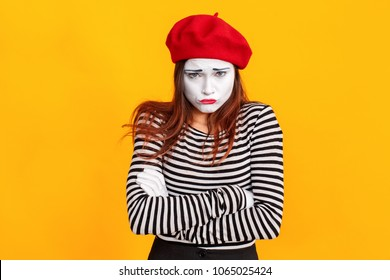 Portrait of cute mime woman crossed hands, have sad look