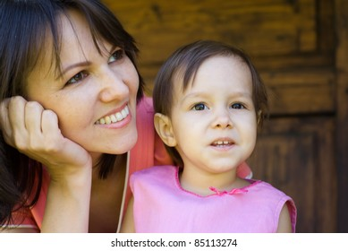 portrait of a cute mom posing with daughter