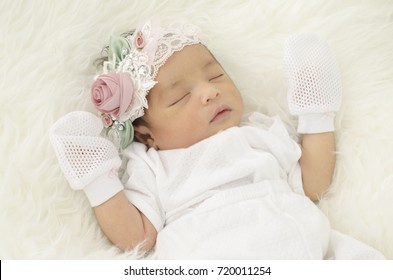 Portrait of cute newborn baby sleeping on white blanket.selective focus shot