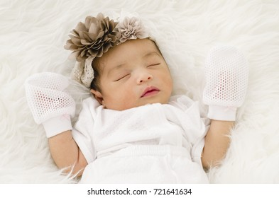 Portrait of cute newborn baby sleeping on white blanket.selective focus shot