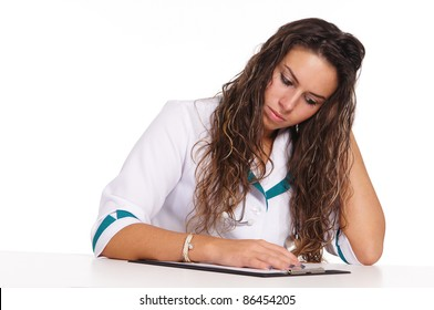 portrait of a cute nurse posing on white
