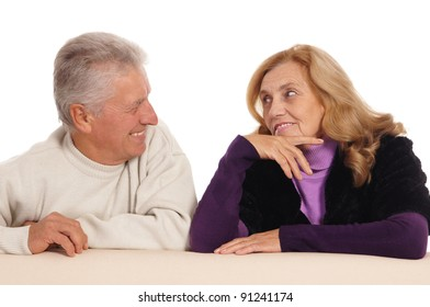 portrait of a cute old couple at sofa