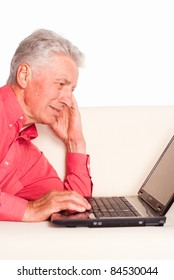portrait of a cute old man with laptop