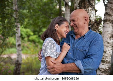 Portrait of cute older man and woman in birch grove