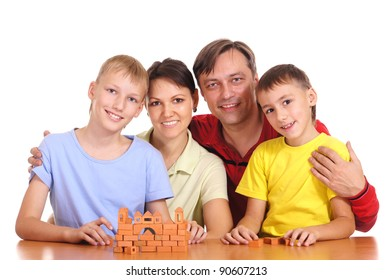 portrait of a cute parents constructing  with sons