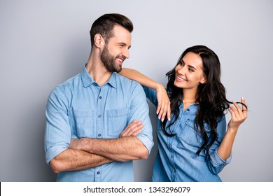 Portrait of cute pleasant adorable guy lady trying to go on date touching shoulder curls by hand fingers looking tender gentle wearing denim outfit on argent background