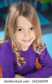 Portrait of cute preschool girl smiling in kindergarten