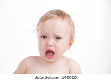 Portrait of cute sad crying baby. Looking at camera and isolated over white background