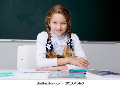 Portrait of cute schoolgirl.Back to school, education concept.