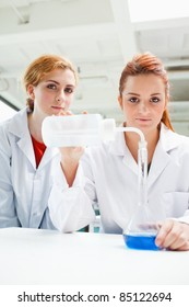 Portrait of cute scientists doing an experiment while looking at the camera