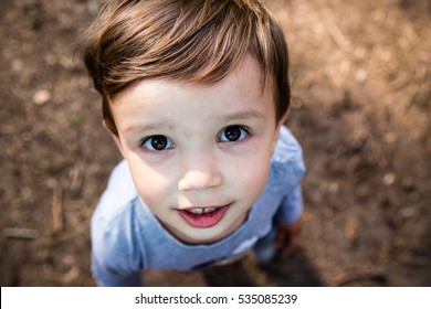 Portrait of cute small boy looking up