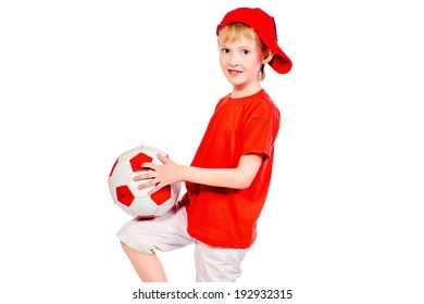 Portrait of a cute smiling 7 years old boy with a ball. Isolated over white.