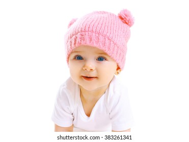 Portrait cute smiling baby in knitted pink hat on white background