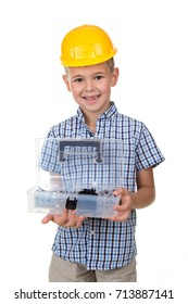 Portrait of cute smiling boy wearing blue checkered shirt and yellow hardhat, holding opened toolbox, white background