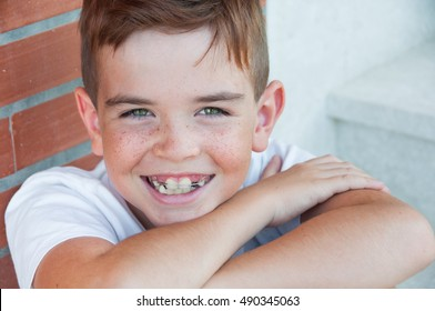 Portrait of a cute smiling child with freckles