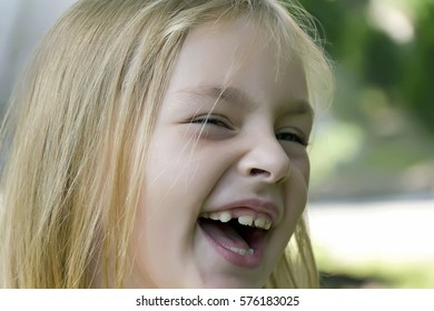 Portrait of cute smiling girl with blond hair