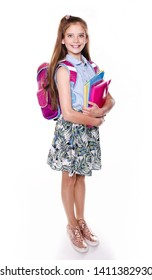 Portrait of cute smiling happy little school girl child teenager with school bag backpack and books isolated on a white background education concept