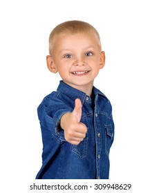 Portrait of a cute smiling little boy with thumb up in denim blue shirt isolated on white background