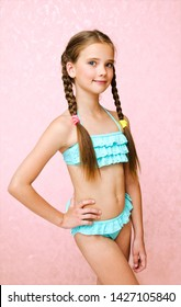 Portrait of cute smiling little girl child schoolgirl in swimsuit isolated fashion concept