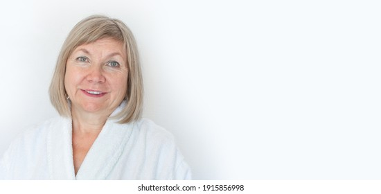 Portrait of a cute smiling senior woman Anti-aging concept. Mature woman's face after spa treatment. Old age in joy, about seniority, cutie grandmother, healthcare, cosmetology, pensioner