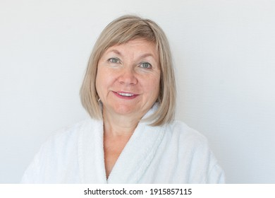 Portrait of a cute smiling senior woman Anti-aging concept. Mature woman's face after spa treatment. Old age joy, about seniority, cutie grandmother, healthcare, cosmetology, new senior