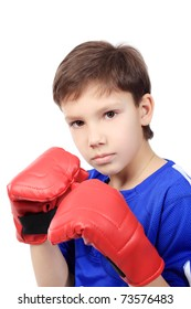 Portrait of a cute sporty boy in boxing gloves. Isolated over white background.