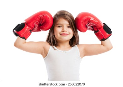 Portrait of a  cute but strong boxer girl on white background
