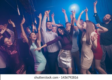 Portrait of cute stylish trendy people millennia delighted content close eyes have fun funny funky move raise hands dress gown suit beautiful handsome indoors