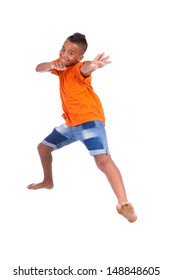 Portrait of a cute teenage black boy jumping over white background - African people
