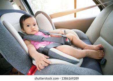 Portrait of cute toddler girl sitting in car seat. Child transportation safety,Asia cute 8 months old  to 10 months old
