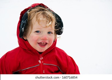 Portrait of cute toddler out in snow