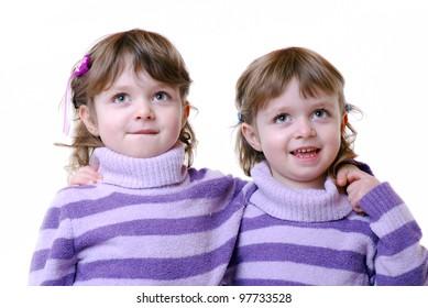 portrait of cute twin girls