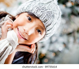 Portrait of a cute winter girl wearing warm clothes