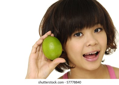 portrait of cute woman holding green lime