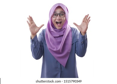 Portrait of cute young Asian muslim lady wearing hijab shows surprised or shocked expression with open mouth, close up happy facial expression isolated on white