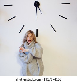 Portrait of a cute young blonde on the big dial, the mode of the day concept