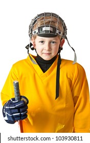 Portrait of cute young boy in hockey uniform with facial mask on top of the head