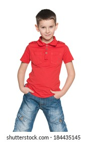 A portrait of a cute young boy in a red shirt on the white background