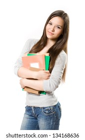 Portrait of cute young brunette student holding exercise books.