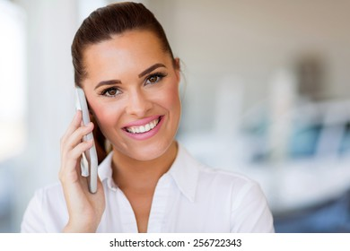 portrait of cute young businesswoman talking on mobile phone