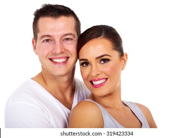portrait of cute young couple on white background