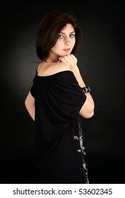 Portrait of cute young female over black background