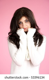 Portrait of cute young female with white sweater over pink background